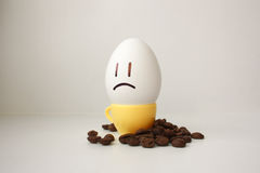Egg with a face. Funny and cute to a coffee mug Stock Images