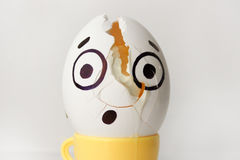 An egg with a face. Funny and sweet. HEADACHE. Stock Photo