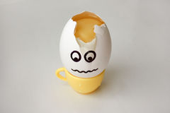 An egg with a face. Funny and sweet. HEADACHE. Stock Image
