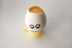 An egg with a face. Funny and sweet. HEADACHE. HEAD IS SHOCKED. TREAT CUP COFFEE. FILLING IN THE CUP. Photo for your design Royalty Free Stock Image