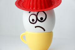 An egg with a face. Funny and sweet. SAD IN THE HAT. Royalty Free Stock Photo