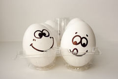 An egg with a face. Funny and sweet. TWO EGGS stock image