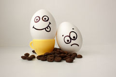 An egg with a face. Funny and sweet. TWO EGGS. stock photos