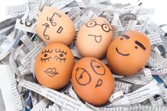 egg face on newspapers recycle Royalty Free Stock Images