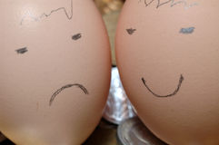 Egg Faces. Happy and Sad Faces drawn on eggs with pencil Royalty Free Stock Photography