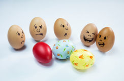 Egg faces and some easter eggs. Egg faces are around some easter eggs royalty free stock image