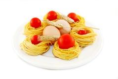 Egg Fettuccine mit Tomaten und den roten Kornähren Stockbild