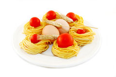 Egg fettuccine with tomatoes and red ears of corn Stock Image