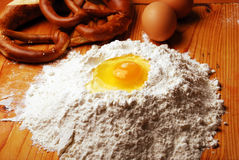 Egg with flour. On a wooden background Royalty Free Stock Image