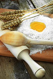 Egg into flour Royalty Free Stock Images