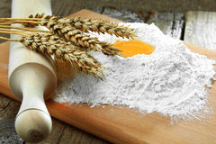 Egg into flour. Preparation of dough from flour and eggs for sacking Royalty Free Stock Images