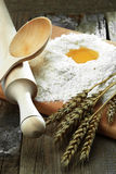 Egg into flour. Preparation of dough from flour and eggs for sacking Royalty Free Stock Photography