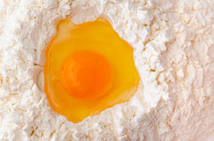 Egg in flour Royalty Free Stock Photos
