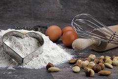 Egg and flour for baking cookies. Raw ingredients for preparing a dough for cookies Stock Image