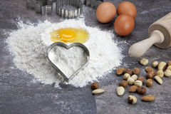 Egg and flour for baking cookies. Raw ingredients for preparing a dough for cookies Royalty Free Stock Image