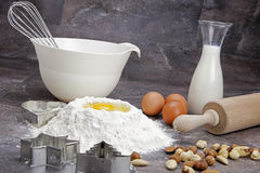 Egg and flour for baking cookies. Raw ingredients for preparing a dough for cookies Royalty Free Stock Images