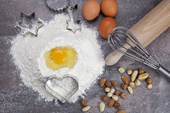 Egg and flour for baking cookies. Raw ingredients for preparing a dough for cookies Stock Photography