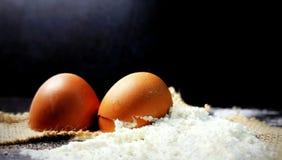 Egg. Flour. Eggshell. White flour. Wheat flour. Spilled flour. Broken eggs. Dough. stock photo