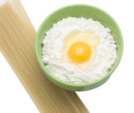 An egg is in a flour and fedelini Royalty Free Stock Photo