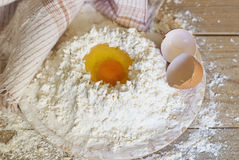 Egg and flour Stock Photos