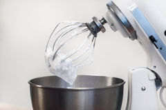 Egg foam on mixer blades. Whipped cream. Cream on the mixer nozzle royalty free stock photography
