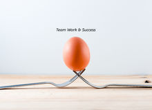 Egg on the fork with text teamwork business concept Royalty Free Stock Image