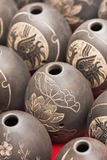 Egg form engraved vases,. Close up photo of a collection handcrafted egg form engraved vases, street market Xian, Shanxi province, China Royalty Free Stock Image