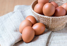 Egg. Fresh eggs in basket on sack Royalty Free Stock Photo