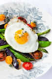 Egg on fresh healthy vegetables light meal option Stock Photography