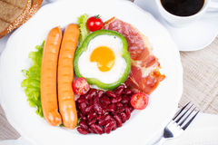 Egg fried in green pepper, sausages, bacon and red beans Royalty Free Stock Photography