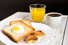 Egg fried in a heart-shaped toast cutout sprinkled Royalty Free Stock Photo