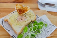 Egg fried in a hole of a slice of bread Royalty Free Stock Image