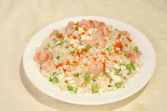Egg fried rice. Background of fried rice with shrimp, ham, bbq pork and egg Stock Image