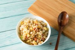 Egg Fried rice with a blue wood grain background royalty free stock photos