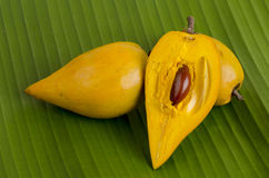 Egg fruit, Canistel, Yellow Sapote (Pouteria campechiana (Kunth) Baehni) on banana leaf background. Stock Photography