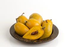 Egg fruit, Canistel, Yellow Sapote (Pouteria campechiana (Kunth) Baehni) on white background. Stock Photo