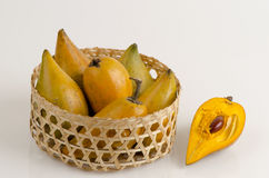 Egg fruit, Canistel, Yellow Sapote (Pouteria campechiana (Kunth) Baehni) on white background. Royalty Free Stock Image
