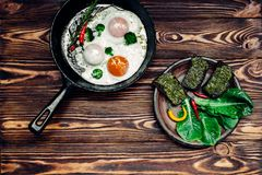 Egg in a frying pan. And a sandwich with pesto Royalty Free Stock Images