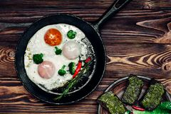 Egg in a frying pan. And a sandwich with pesto Royalty Free Stock Photo