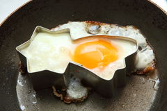 Egg frying in star shape Stock Image