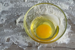 Egg in a glass bowl. An egg in a glass bowl for a pie recipe Royalty Free Stock Photos