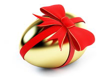 Egg gold with bow Royalty Free Stock Photo