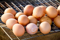 Egg Grill on stainless mesh with focus on Foreground Thai Food i stock images