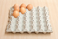 Egg. Half dozen fresh eggs in the paper panel Royalty Free Stock Photography