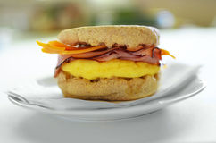 Egg, ham and cheese on whole wheat English muffin Stock Photos