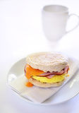 Egg, ham and cheese on whole wheat English muffin Royalty Free Stock Photos