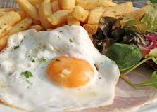 Egg Ham and Chips. Plate of Egg Ham and Chips close-up Stock Images