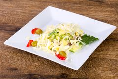 Egg and ham salad. Served parsley royalty free stock photo