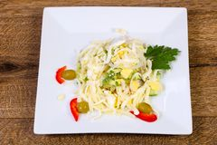 Egg and ham salad. Served parsley royalty free stock image