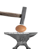 Egg, hammer, and anvil isolated Royalty Free Stock Image